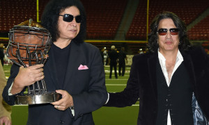 LAS VEGAS, NV - MAY 04:  (L-R) Singer/bassist Gene Simmons and singer/guitarist Paul Stanley of Kiss, owners of the Los Angeles Kiss, and Motley Crue singer Vince Neil, owner of the Las Vegas Outlaws, pose with a rivalry trophy before the two teams played each other at the Thomas & Mack Center on May 4, 2015 in Las Vegas, Nevada. Las Vegas won 49-16.  (Photo by Ethan Miller/Getty Images)